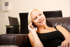 Girl talking with a Smartphone Royalty Free Stock Photos