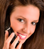 Girl Talking to a Cell Phone Stock Image