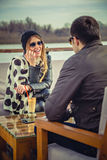 Girl talking to her friend. While sitting by the river Royalty Free Stock Photos