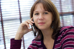The girl talks by a mobile phone Stock Photos