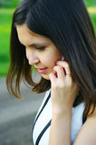 Girl talks by a mobile phone Royalty Free Stock Photos