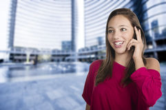 Girl talks by mobile phone Stock Images