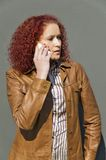 Girl talks by phone. Beautiful girl talks by phone Stock Images
