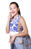 A girl talks by phone Stock Photography