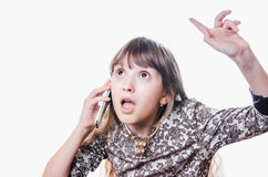 The girl talks and swears by phone Royalty Free Stock Photo