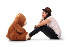 Girl talks with teddy stock images