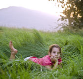Girl in tall grass Stock Images