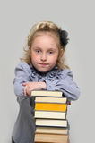 Girl and a tall stack of books Royalty Free Stock Image