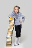 Girl and a tall stack of books Royalty Free Stock Photo