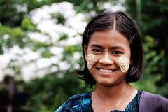Girl with Tanaka cream on her cheeks Stock Photos