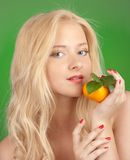Girl with tangerine Royalty Free Stock Photo