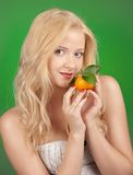 Girl with tangerine Stock Photography