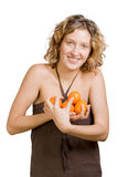 Girl with tangerine Stock Photos