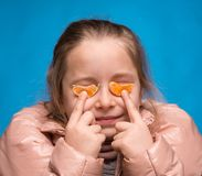 Girl with tangerine glasses Stock Photo
