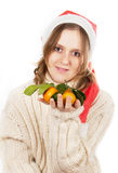 The girl with tangerines Stock Photos