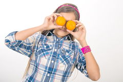 Girl and tangerines. Stock Photos