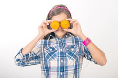 Girl and tangerines. Stock Images
