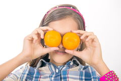 Girl and tangerines. Stock Image