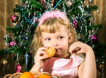 Girl with tangerines in Christmas Royalty Free Stock Image