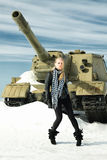 Girl and a tank Royalty Free Stock Images