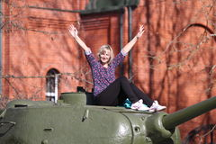 The girl and tank Royalty Free Stock Photos