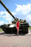 A girl and a tank 4 Royalty Free Stock Photos