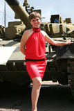 A girl and a tank  2 Royalty Free Stock Photography