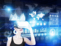 Girl in tank top, vr glasses and graphs Stock Image