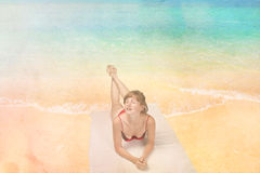 Girl tanning on the beach Royalty Free Stock Photo