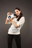 Girl with tape-recorder Stock Images