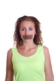 Girl with tape sealed her mouth Stock Photo