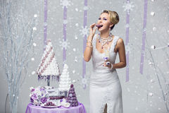 Girl tasting cake Stock Photo