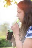 Girl tasting spirulina algae drink Stock Photo