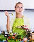 Girl tasting vegetable salad Stock Image