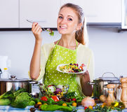 Girl tasting vegetable salad Stock Photo