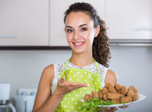 Girl with tasty breadcrumbed crocchette Stock Photos