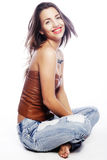 Girl with tattered jeans sit on floor. Attractive girl with tattered jeans sit on floor Royalty Free Stock Images