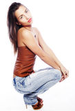 Girl with tattered jeans sit on floor Stock Photography