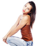 Girl with tattered jeans sit on floor Stock Image