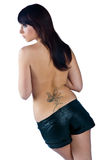 Girl with tattoo. Girl with fairy tatto on her back royalty free stock photography