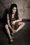 Girl with tattoo. Asian girl with tattoo on the floor Royalty Free Stock Images