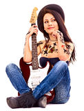 Girl with tattoo playing guitar. Stock Photography