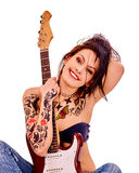 Girl with tattoo playing guitar Stock Images