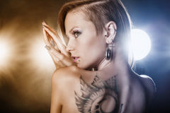 Girl with tattoos and piercings stock image