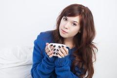 Girl with tea Stock Photography