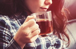 Girl with tea Stock Images