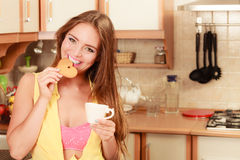 Girl with tea coffee eating gingerbread cookie. Royalty Free Stock Photo