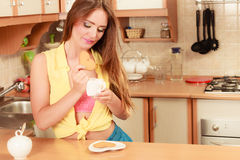 Girl with tea coffee eating gingerbread cookie. Royalty Free Stock Photos