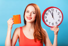 Girl with tea cup and clock Stock Photos