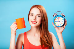 Girl with tea cup and clock Stock Images
